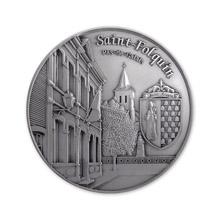 Médaille composition avec bateau